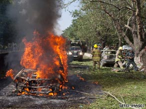 A car burns after the suicide blast outside NATO's Afghanistan headquarters.