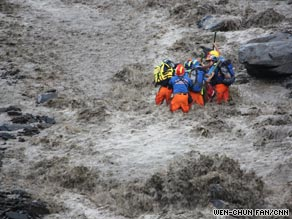 Rescuers brave raging torrents to pull survivors from mudslides in Taiwan.