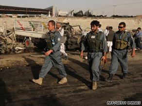 Afghan police survey the scene of a suicide car bomb Tuesday in Kabul, two days before national elections.