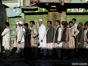 Afghans in Kabul queuing to cast their vote in the country's pivotal elections.