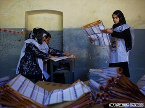 Electoral workers count votes at a school in Kabul.