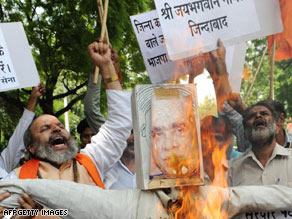 Protesters burn an effigy of Jaswant Singh over his book; the former foreign minister was ousted from his party.