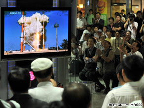 South Koreans at a railway station in Seoul watch the launch of the Korea Space Launch Vehicle-1 Tuesday.