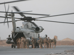 U.S. Marines, with Afghan soldiers and police, board a helicopter at Forward Operating Base Dwyer, Afghanistan.