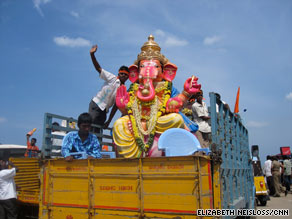 A Ganesha idol is loaded on to a fishing boat in the Bay of Bengal -- ready to be immersed.