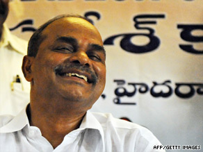 Chief Minister of Andhra Pradesh Y.S.R. Reddy smiles at the Congress party office in Hyderabad on May 16.