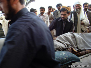 A victim of an ISAF airstrike on a hijacked oil tanker is carried into the Kunduz hospital on Friday.
