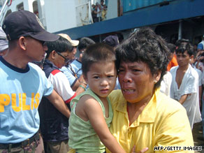 Survivors of the accident pack the decks of a cargo ship arriving in Zamboanga, Philippines, on Sunday.
