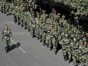 Chinese troops march in Urumqi, the capital of the Xinjiang Uyghur autonomous region, on September 5.