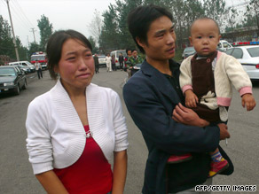 Family members arrive to find out the fate of miners Pingdingshan, China, on Tuesday.