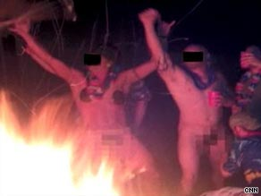 Images released by a watchdog group show raucous partying and sexual hazing by private embassy guards.
