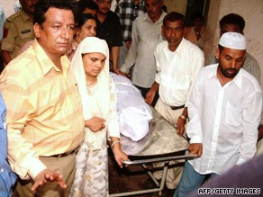 Relatives collect the body of Ishrat Jehan from Civil Hospital in Ahmedabad on June 18, 2004.