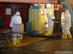 Workers remove fuel rods from the Yongbyon nuclear reactor in North Korea in February 2008.
