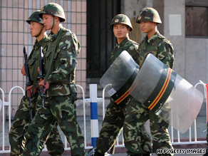Chinese troops patrol the streets of Urumqi.