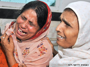 Pakistani women mourn relatives' deaths Monday at a Karachi hospital after a stampede.