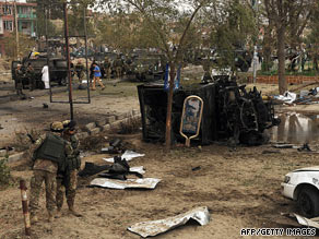 Italian soldiers stand near their vehicle, destroyed by a car bomb in Kabul, Afghanistan, on Thursday.