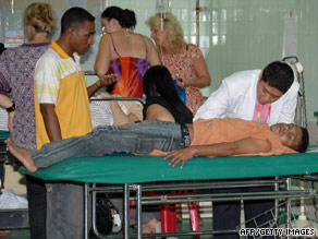 An doctor in Bali, Indonesia, treats a man injured during the earthquake on Saturday.