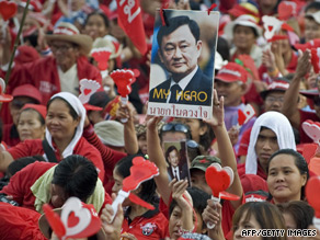 Red-shirted demonstrators hold up a picture of Thaksin Shinawatra at Royal Plaza in Bangkok.