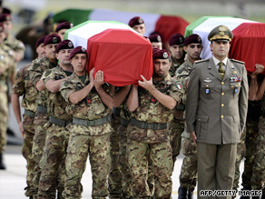 The coffins of six Italian soldiers killed in a suicide attack in Kabul return to Rome.