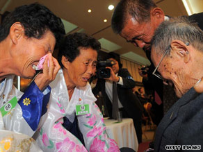 South Korean Kim Won-Myung, right, is greeted by relatives during the first reunion of separated familes in two years.