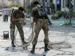 Soldiers secure a site where a bomb blast took place in Peshawar, Pakistan, on Saturday.