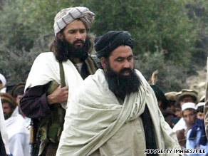 Baitullah Mehsud, right, and a bodyguard in Pakistan in 2004.