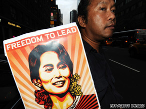 A Myanmar pro-democracy supporter displays a poster outside the United Nations in New York.