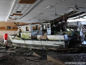 A damaged boat washed up inside a building in Pago Pago, American Samoa.
