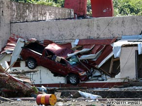 A truck is left embedded in a damaged building in Pago Pago following the tsunami late Tuesday.