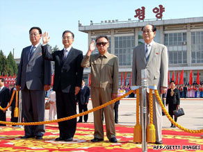 This KCNA photo shows Chinese Premier Wen Jiabao, second left, next to N. Korean leader Kim Jong Il, waving.