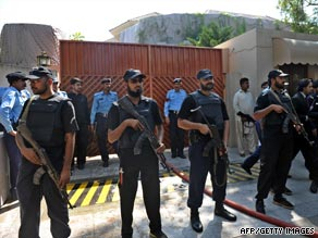Pakistani police commandos stand in front of a U.N. office after a suicide blast in Islamabad on Monday.