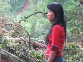 Septiani Lenianingsih watches as villagers and emergency workers dig for bodies.
