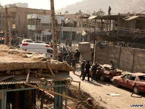 Afghan policemen inspect the site of a suicide car bomb explosion near the Indian Embassy.
