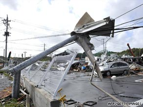 Utility poles lie buckled in the wake of Typhoon Melor.