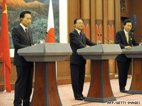 From left: S. Korean President Lee Myung-Bak, Chinese Premier Wen Jiabao, Japanese PM Yukio Hatoyama in Beijing, China, on October 10.