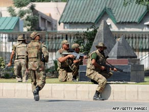 At least 10 people were killed in the assault on the army headquarters in Rawalpindi.