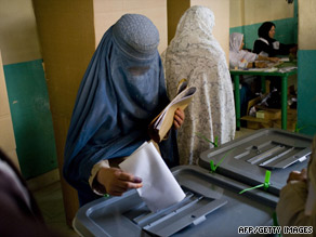 An Afghan woman casts her ballot at a polling station in Kabul on August 20.