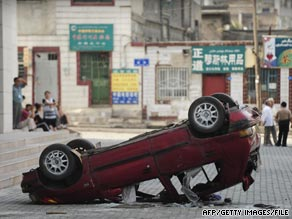 A car lies overturned in the wake of the July unrest in China's Xinjiang province.