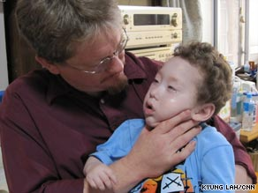 Spencer Morrey, pictured with his father Craig, has severe cerebral palsy and requires 24-hour medical care.