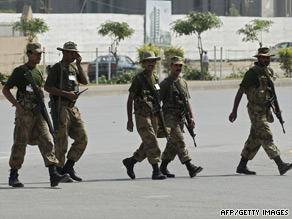 Soldiers march at army HQ in Rawalpindi Tuesday, three days after militants took dozens of hostages in a siege.