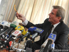 Bernard Kouchner addresses reporters in the French embassy in Kabul.