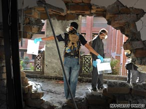 Police investigators collect evidence at the suicide blast site at Islamic International University in Islamabad.
