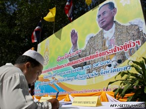 A well-wisher signs a get well petition for Thailand's King Bhumibol Adulyadej.