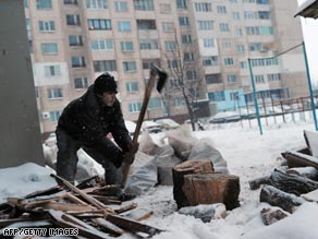 A Bulgarian man chops wood for heating after their gas supplies were cut.