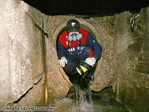 Italian police examine a sewer that may have offered an escape route for a suspected mafia boss.