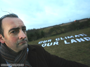 Greenpeace protesters demonstrate on the roof of an aircraft at Heathrow airport last year.