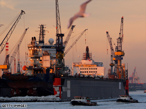 Snow-covered ice floats down the Elbe river in Hamburg, Germany, as the temperature plummets.