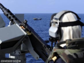A soldier looks at a Yemeni fishing boat from a French frigate. Spanish troops are due to join the EU task force.