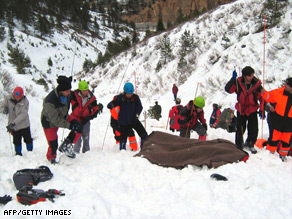 Rescuers recover a body at the scene of an avalanche in northeastern Turkey that killed 10 people.