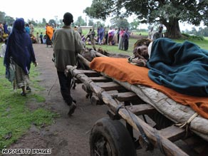 Bedatu, a woman suffering from malnutrition, is wheeled to a medical center in Kuyera, Ethiopia, in September.